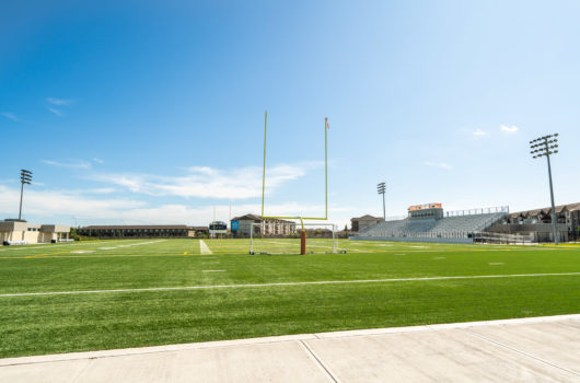 football-soccer-field-blue-sky
