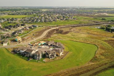 aerial-shot-development-neighborhood-dirt-road