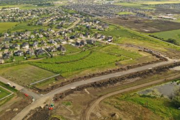 aerial-development-shot-neighborhood-dirt-road